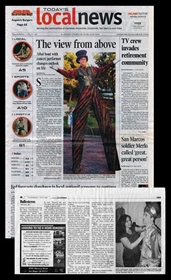 stilt walkers newspaper