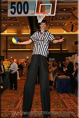 stilt walker basket ball