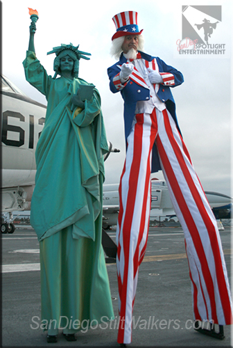 stilt walker uncle sam liberty lady statue