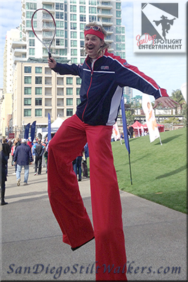 stilt walkers tennis guy